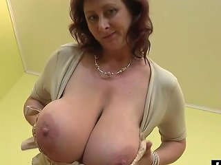 Long Dildo Makes This Cougar Moan